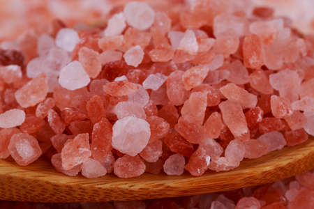 Himalayan pink salt in a wooden spoon
