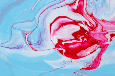 Abstract background of acrylic paint in blue and red tones Фото со стока