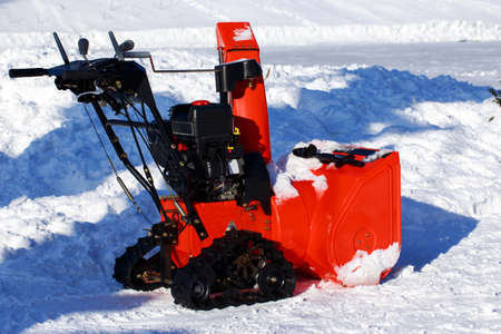 Red snow machine to clear the road