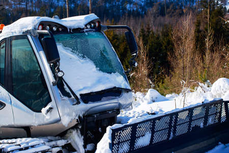 The ski slope preparation machine clears snow Imagens
