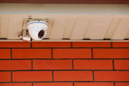 Big surveillance camera on the wall close-up