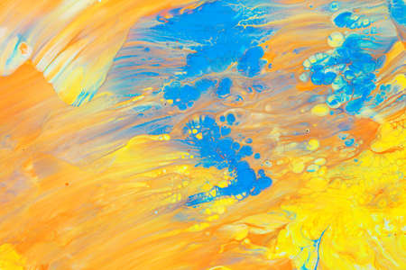 Abstract background of acrylic paint in blue and Orange tone