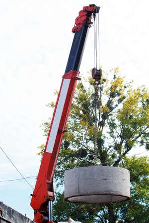 Crane with hooks raises heavy concrete structure