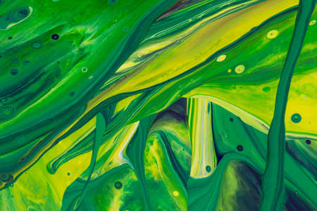 Abstract background of acrylic paint in green and yellow tone