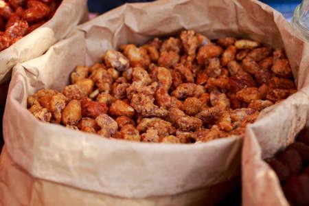 Sugar-coated cashews at a street food festival