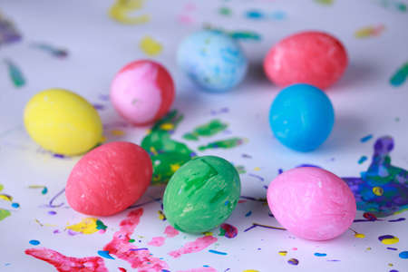Eight colored eggs on an abstract background