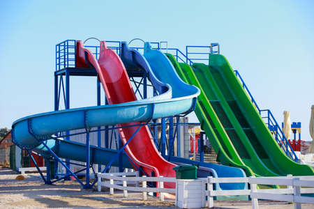 Colored water slides on a background of blue clear sky