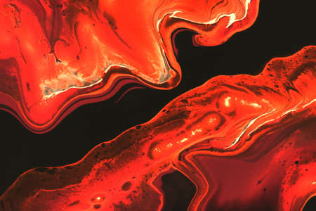 Abstract background of acrylic paint in orange tones 免版税图像