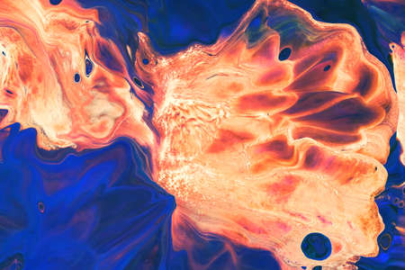 Abstract background of acrylic paint in orange and blue tones