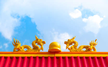 festival scales: Dragon statue on red roof