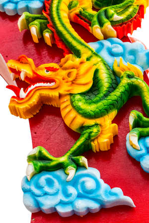 festival scales: Dragon statue on red statue on white background