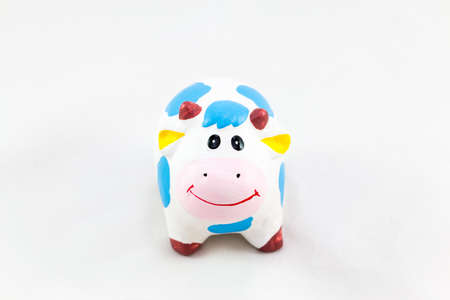 funny ox: Hardened clay smile Cow  on White Background Stock Photo