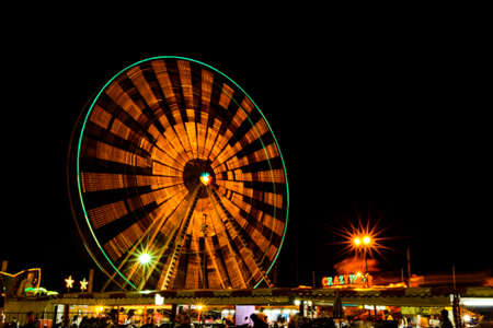 ferriswheel: Wheel at a carnival at night