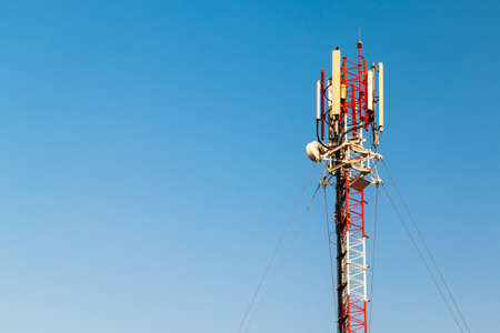 repeater: Close up  color antenna repeater tower on blue sky Stock Photo
