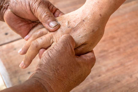 complementary therapies: Close up woman hand massage by old mans hands