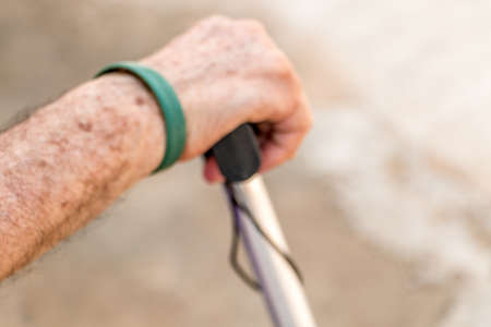 baton: old man with a baton
