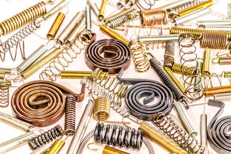 metal parts: Many Spiral spring on white background