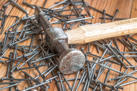 long nails: Dirty Hammer and long nails on wood background
