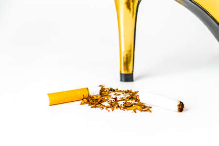 toxic substance: world no tobacco day concept, shoe put on Broken cigarette on white background.