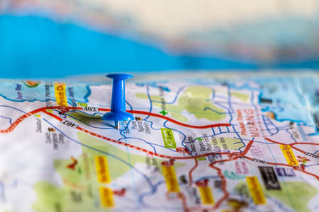 travel destination pin points on a map with colorful thumbtacks