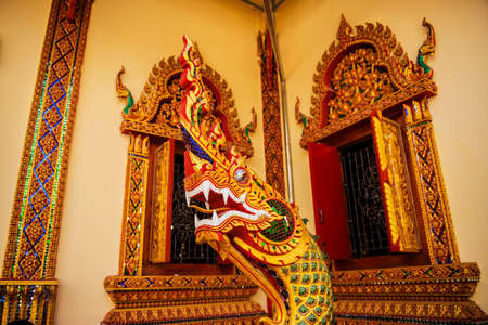 Thai wall art in the temple photo
