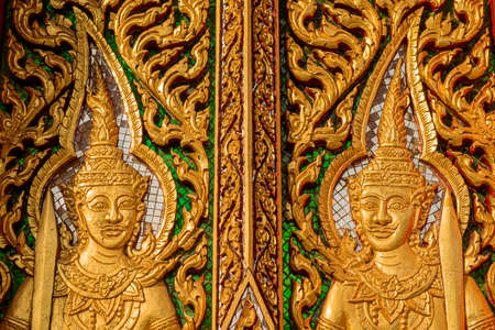 wood carving door: wood carving door decorated in the temple ,Thailand  Stock Photo