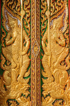 wood carving door: wood carving door decorated in the temple ,Thailand