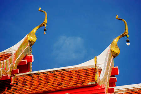 thai temple roof with blue sky ,Thailand photo