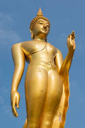 Standing golden buddha statue Tak , Thailand photo