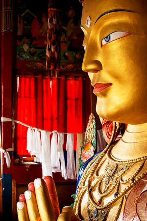 close up colorful sculpture of Maitreya buddha at Thiksey Monastery, Tibetan Buddhist monastery in Ladakh photo