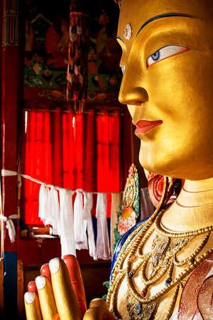 maitreya: close up colorful sculpture of Maitreya buddha at Thiksey Monastery, Tibetan Buddhist monastery in Ladakh Stock Photo