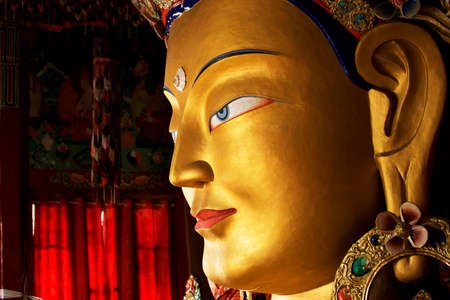 future buddha: close up colorful sculpture of Maitreya buddha at Thiksey Monastery, Tibetan Buddhist monastery in Ladakh Stock Photo
