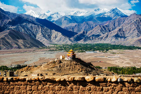 Golden roof monastery and snow mountain range Leh Ladakh ,India - September ,2014 photo