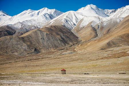 pavilion and snow mountain range at Pangong Lake Leh Ladakh ,India - September 2014 photo