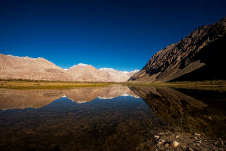 snow mountain range and reflection Leh Ldakh ,India - September 2014 photo
