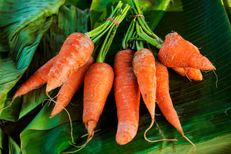 villager: carrots with banana leafs background from the villager market northern of Thailand - January 2015 Stock Photo