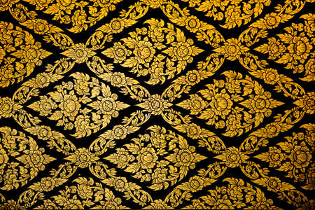 traditional Thai style art gold painting pattern on wall in temple - January 2015,This work is public in thailand. No any trademark or restrict matter in this photo photo
