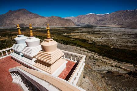 amazing stunning: Three stupa and blue sky at Diskit monastery, Ladakh, India - September 2014