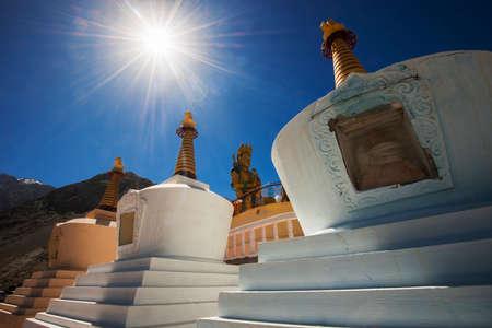 Three stupa and blue sky at Diskit monastery, Ladakh, India - September 2014 photo