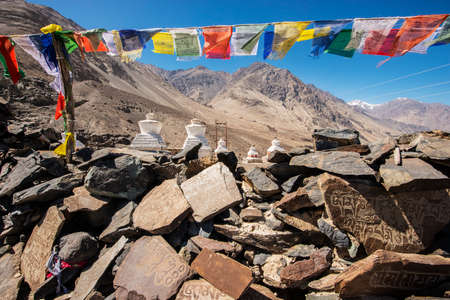 Stupa and player flags near Diskit monastery in Ladakh, Jammu & Kashmir, India - September 2014 photo