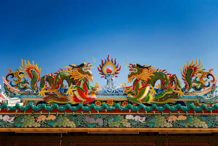 colorful dragon statue on the roof Chinese temple in Tak Province ,Thailand photo