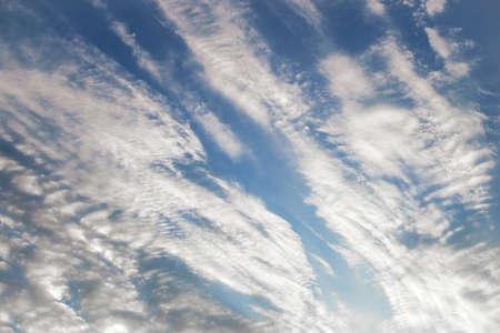 cumuli: Close up dramatic fluffy clouds during sunset after rain