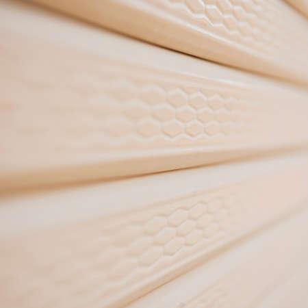 Close up yellow metal roller door shutter background and texture photo
