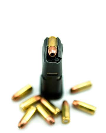 glock: 9mm bullets and magazine isolated on white background. Stock Photo