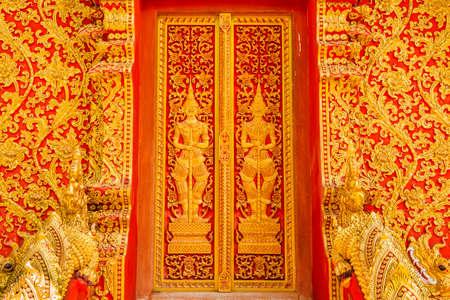 art door: art door carving guardian giant in the temple ,Thailand Stock Photo