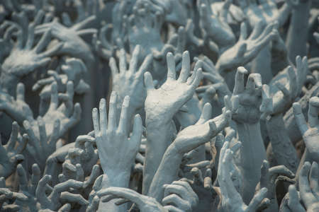 Ghost hands from hell, Conceptual sculpture decorations in Rongkhun Temple Chiangrai, Thailand photo
