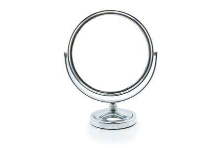Old silver makeup mirror isolated on white