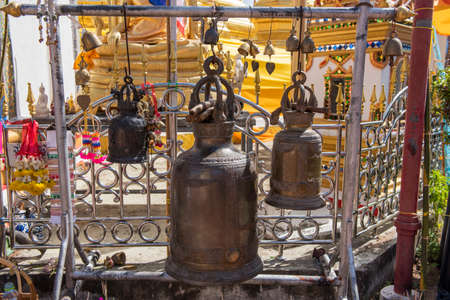 bell bronze bell: Large bronze buddhist bell at Phra Borommathat temple Stock Photo