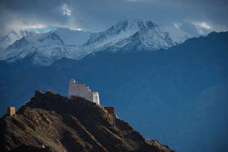 gompa: Namgyal Tsemo Gompa from behind and snow mountain range background Leh, Ladakh, India. Stock Photo