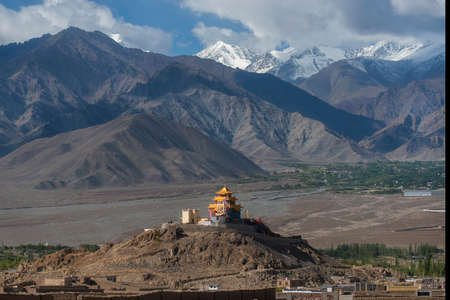tibetan house: Golden roof monastery and snow mountain range Leh Ladakh ,India
